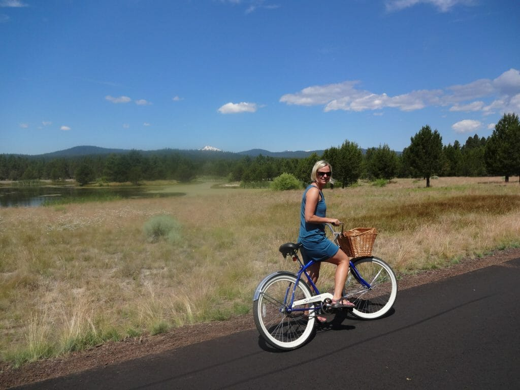 Pausing on a ride in Sun River, Oregon. That's Mt. Hood in the distance.